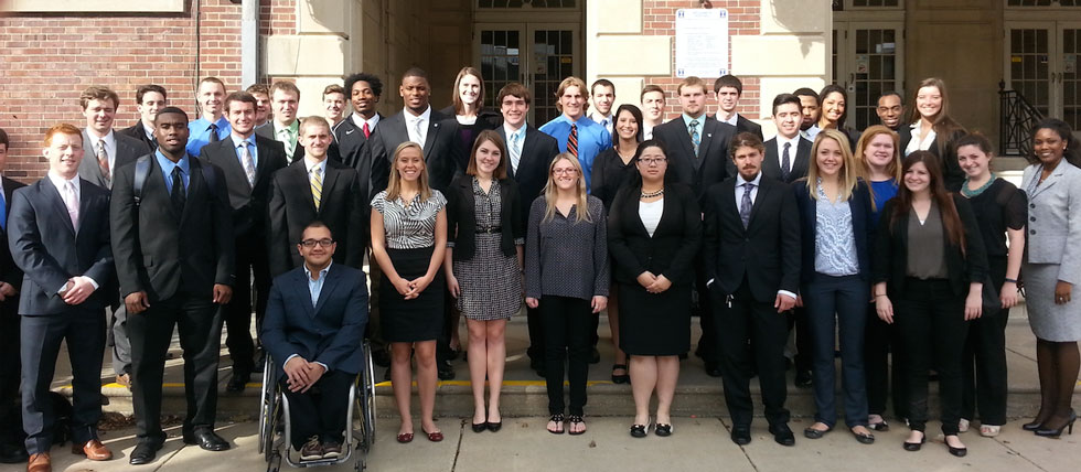group of 40 sudents standing on entrance steps of Huff Hall
